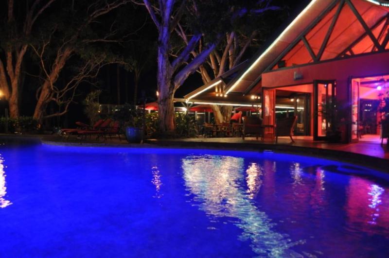 Pool & Sandbar restaurant at night - Turtle Cove Beach Resort