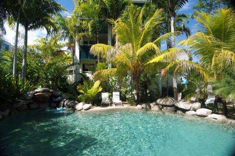 Pool surrounded by lush gardens - At Verandahs Boutique Apartments