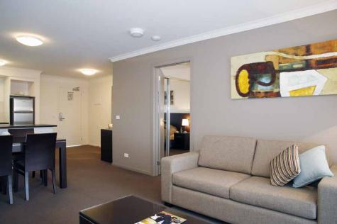 Spacious One Bedroom Apartment Living Area - Quest Sale